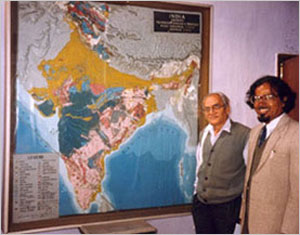 indian geoscientists beside a geological map of the Indian sub-continent
